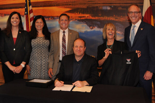 President Greg Salsbury visits Capitol for Governor's signing of simplified name: Western Colorado University